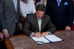 Governor Perry signing the bill