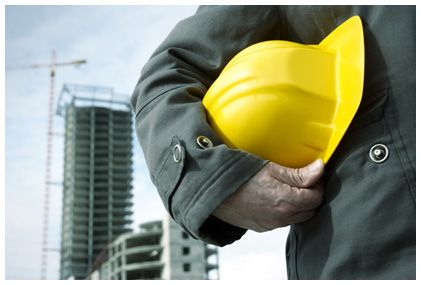 Worker holding a yellow hard hat