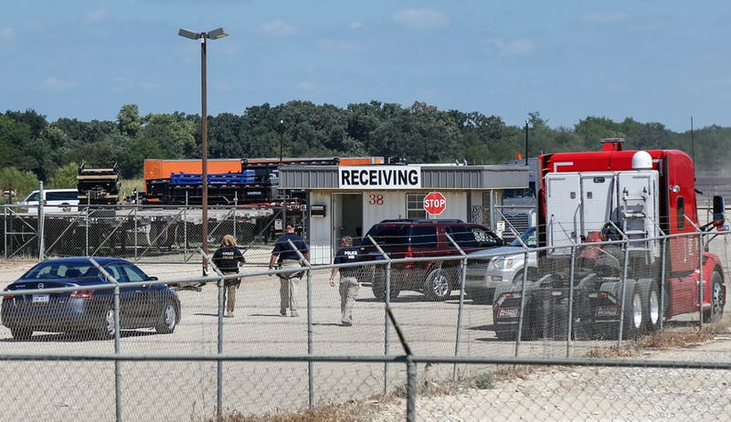 U.S. Immigration and Customs Enforcement agents are seen at the receiving gates of Load Trail, a Sumner-based business agents raided for undocumented workers Tuesday morning. (Lora Arnold/Paris News)(Lora Arnold)